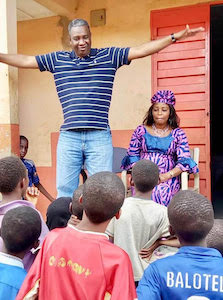 Lamin Bah Mentoring Children at Schools and Orphanages